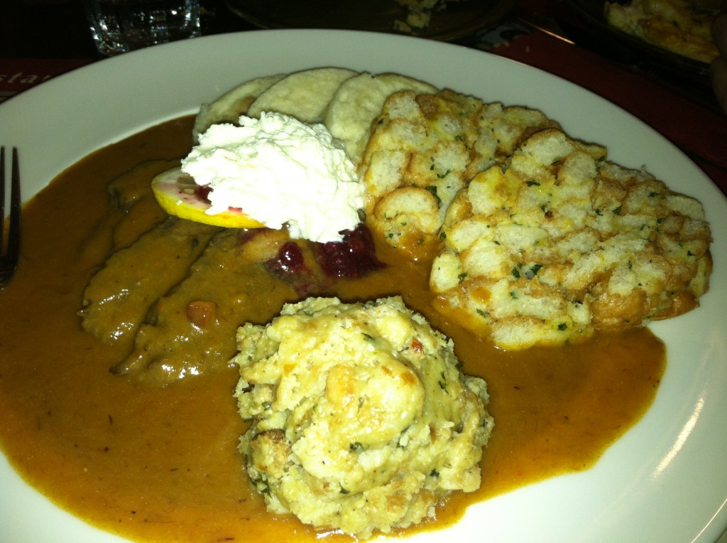 Beef tenderloin with lemon, cranberries and whipped cream, along with an assortment of dumplings. Some of which are filled with BACON.