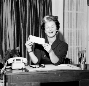 This lady is happy with her pay check. Photo courtesy of Getty Images