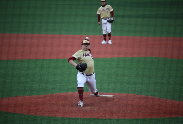 BC Baseball pitcher throwing the ball on the mound.