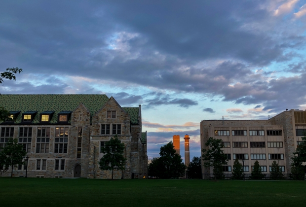 The new central heating system at Boston College, smoke stakes between devlin and mcguinn, at golden hour