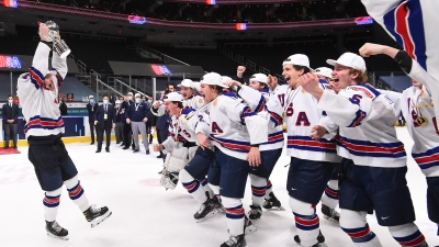 Photo shows USA world juniors hockey team celebrating after their win against Canada.