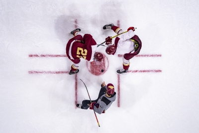 Photo of players at the puck drop from above.